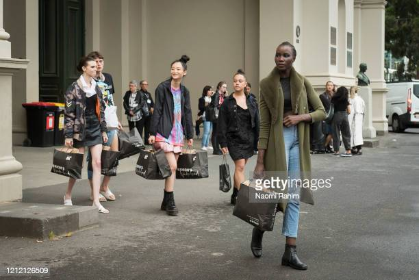 Models leave the Royal Exhibition Building in full makeup on March 13 2020 in Melbourne Australia Melbourne Fashion Festival organisers announced on...