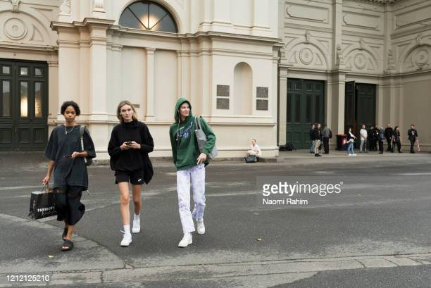 Models leave the Royal Exhibition Building on March 13 2020 in Melbourne Australia Melbourne Fashion Festival organisers announced on Friday...