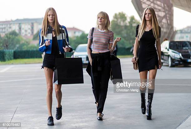 Models Lexi Boling Hanne Gaby Odiele and Anna Ewers outside Versace during Milan Fashion Week Spring/Summer 2017 on September 23 2016 in Milan Italy