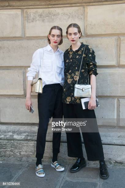 Models Lia and Odette Pavlova carrying Bvlgari bags day 3 of Paris Haute Couture Fashion Week Autumn/Winter 2017 on July 4 2017 in Paris France