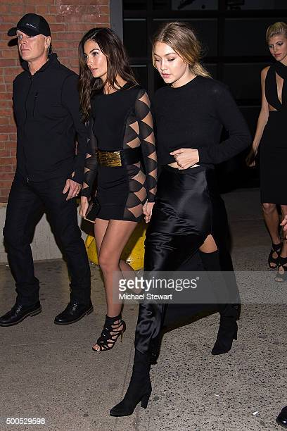 Models Lily Aldridge and Gigi Hadid attend the 2015 Victoria's Secret Fashion Show viewing party at Highline Stages on December 8 2015 in New York...