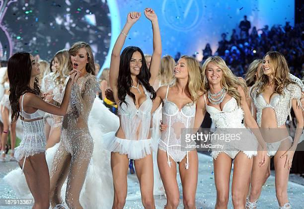 Models Lily Aldridge, Karlie Kloss, Adriana Lima, Doutzen Kroes, Candice Swanepoel, and Behati Prinsloo walk the runway at the 2013 Victoria's Secret...