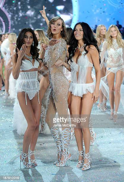 Models Lily Aldridge Karlie Kloss and Adriana Lima walk the runway at the 2013 Victoria's Secret Fashion Show at Lexington Avenue Armory on November...