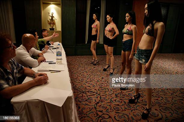 Models line up to meet the judges for interviews during a boot camp during the Elite Super Model Contest on October 26 in Chiang Mai Thailand The...