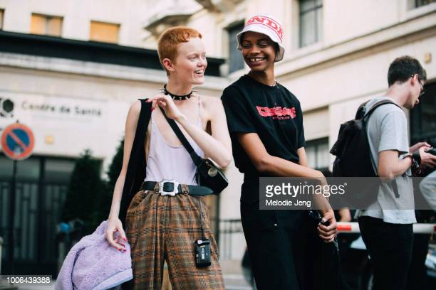 Models Liz Ord Aaliyah Hydes after the Kenzo show during Paris Fashion Week Mens Spring/Summer 2019 on June 24 2018 in Paris France Li wears a...