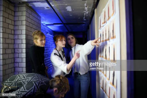 Models look at the model board ahead of the Dawid Tomaszewski show during the MBFW January 2018 at ewerk on January 15 2018 in Berlin Germany