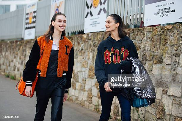 Models Lorena Maraschi Amanda Googe after the Loewe show on September 30 2016 in Paris France Lorena wears an orange and black Diesel Black Gold...