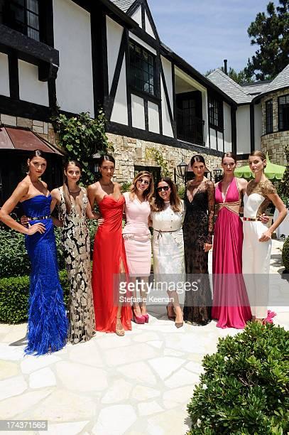 Models Lorena Sarbu and Deborah Waknin attend Lorena Sarbu Resort 2014 Luncheon at on July 24 2013 in Beverly Hills California
