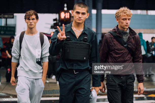 Models Luc DefontSaviard Sakua Kambong and Peter Dupont after the Boss show during New York Fashion Week Spring/Summer 2019 on September 9 2018 in...