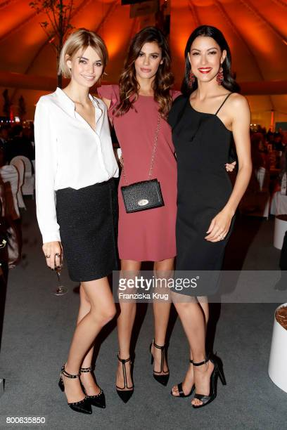 Models Luisa Hartema Alisar Ailabouni and Rebecca Mir attend the Gerry Weber Open Fashion Night 2017 during the Gerry Weber Open 2017 at Gerry Weber...