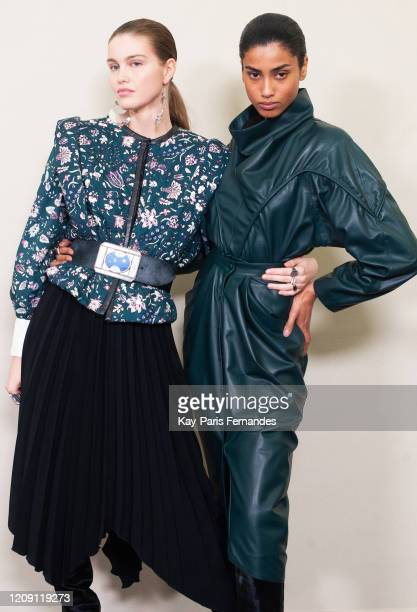 Models Luna Bijl and Imaan Hammam pose backstage in firstlooks before the Isabel Marant Womenswear Fall/Winter 2020/2021 show as part of Paris...