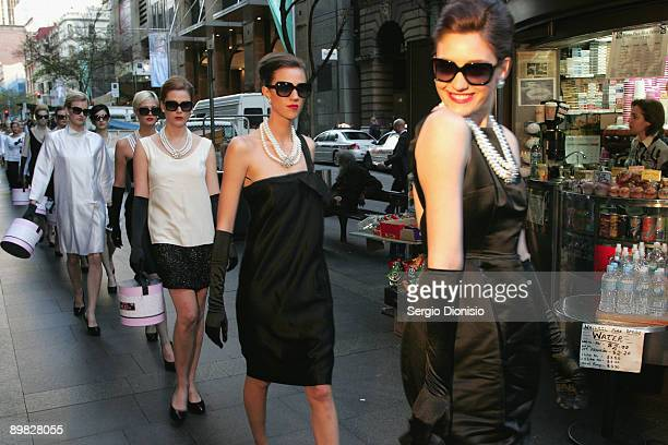 Models madeup to look like screen star Audrey Hepburn parade though Sydney's central business district to celebrate Hepburn's 80th birthday this year...