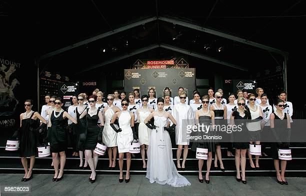 Models madeup to look like screen star Audrey Hepburn pose in front of the Rosemount Sydney Fashion Festival Marquee to celebrate Hepburn's 80th...