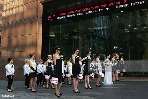 Models madeup to look like screen star Audrey Hepburn pose in front of channel seven studio's to celebrate Hepburn's 80th birthday this year and...