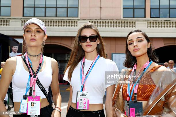 Models Madison Headrick Josephine Skriver and Olivia Culpo pose for a photo in the paddock before the F1 Grand Prix of Monaco at Circuit de Monaco on...