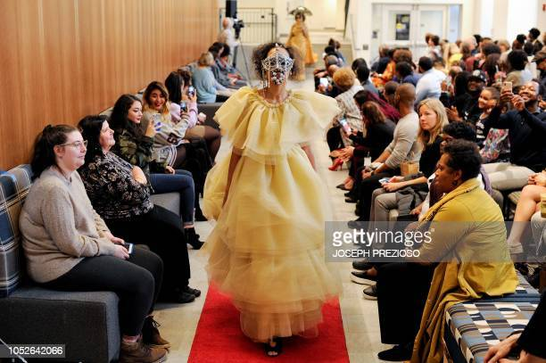 Models make their way down the runway to a packed room during the 3018 fashion show at the 12th Annual Black New England Conference at the University...