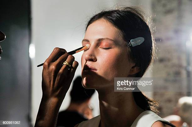 A model's makeup is done during the Ulla Johnson presentation at Skylight at Industria Superstudio on September 8 2016 in New York City