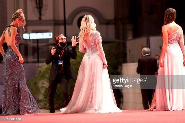 """Models Mariagrazia Donadoni, Sofia Bartoli and Alessia Pasqualon walk the red carpet ahead of the movie """"Di Yi Lu Xiang"""" during the 77th Venice Film..."""