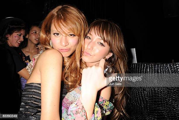Models MARIE and Lena Fujii arrive at the Charlotte Ronson S/S 2009 Fashion Show after party on October 22 2008 in Tokyo Japan