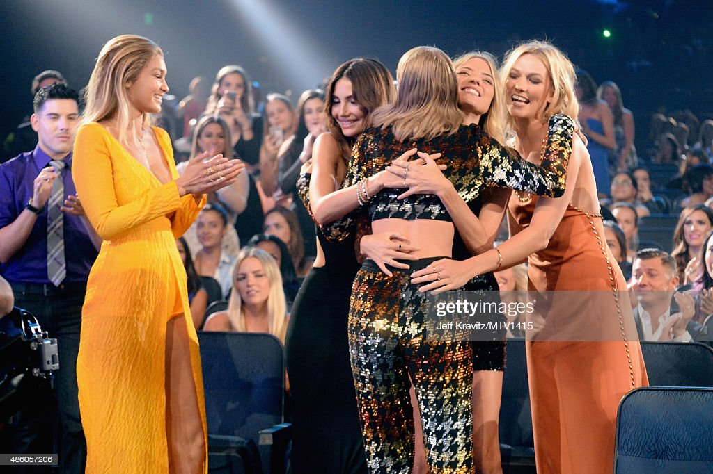 Models Martha Hunt, Lily Aldridge, Gigi Hadid and Karlie Kloss hug Taylor Swift after she wins the Video of the Year award at the 2015 MTV Video Music Awards at Microsoft Theater on August 30, 2015 in Los Angeles, California.