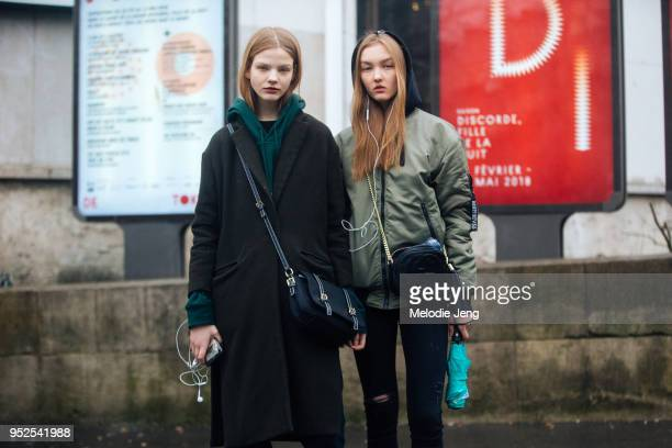 Models Maryna Horda Nastya Cherkasova after the Masha Ma show at Palais de Tokyo on March 04 2018 in Paris France Maryna uses earphones and wears a...