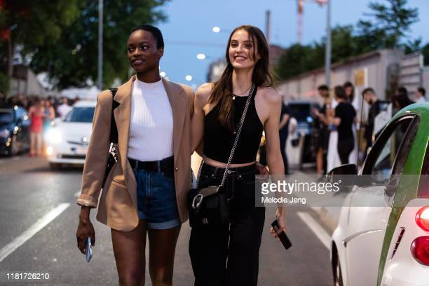 Models Mayowa Nicholas and Camille Hurel after the DSquared2 show during the Milan Men's Fashion Week Spring/Summer 2020 on June 16, 2019 in Milan,...