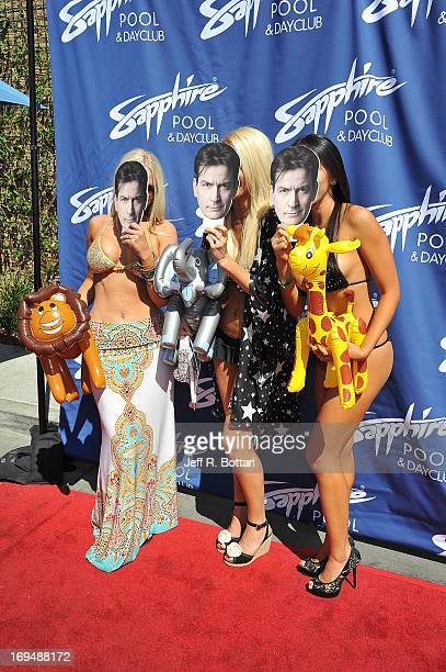Models Melissa Dawn Taylor Crystal Hefner and Caya Hefner hold up cutout faces of Charlie Sheen as they appear at the Sapphire Pool Day Club's...