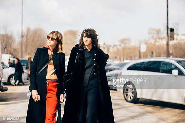 Models Mica Arganaraz and Edie Campbell exit the Chanel show at Grand Palais on March 07, 2016 in Paris, France. Mica wears an all black outfit with...