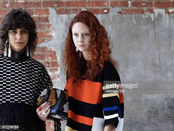 Models Mica Arganaraz and Natalie Westling poses backstage at the Proenza Schouler fashion show during MercedesBenz Fashion Week Fall 2014 on...