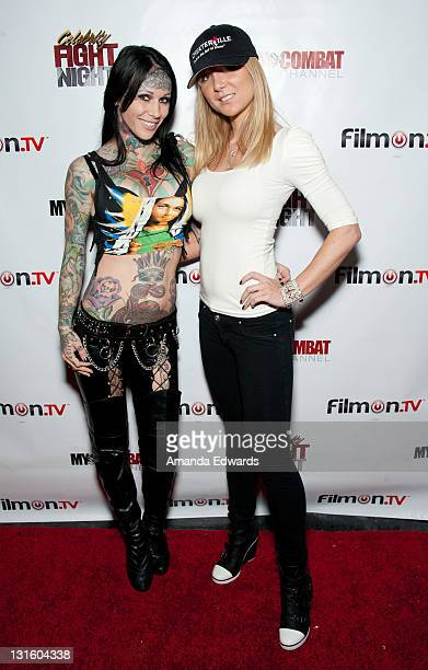 Models Michelle Bombshell McGee and Cami Parker arrive at the FilmOn Celebrity Fight Night at Avalon on November 5 2011 in Hollywood California