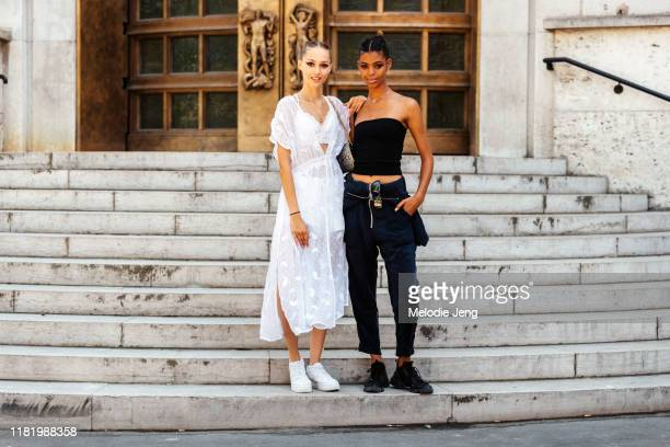Models Michelle Gutknecht and Alyssa Traore after the Elie Saab show during Couture Fashion Week Fall/Winter 2019 on July 03, 2019 in Paris, France....