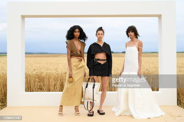 """Models, Mika Arganaraz pose on the first line prior to """"L'Amour"""" : Jacquemus Spring-Summer 2021 show on July 16, 2020 in Paris, France."""
