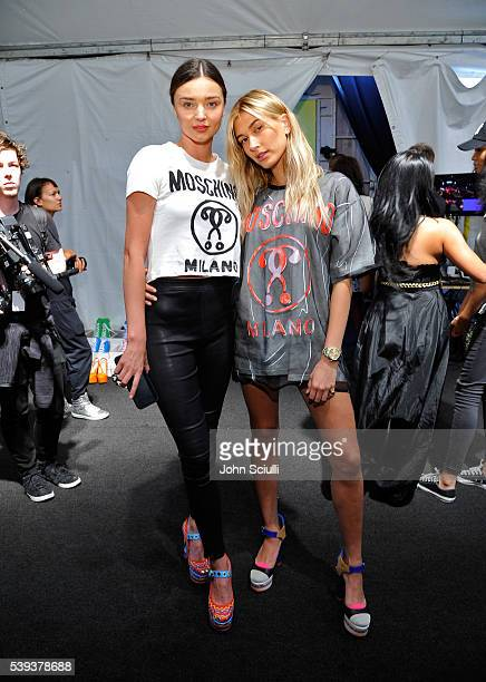 Models Miranda Kerr and Hailey Baldwin pose backstage at the Moschino Spring/Summer 17 Menswear and Women's Resort Collection during MADE LA at LA...
