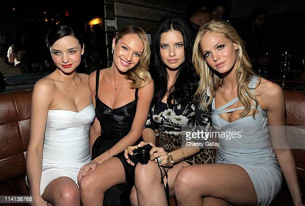 Models Miranda Kerr Candice Swanepoel Adriana Lima and Erin Heatherton attend The Reveal of the What Is Sexy List celebrated by Victoria's Secret...