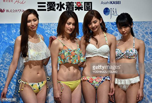 Models Momoko Yokomachi Seira Miyazawa Aya Asahina and Haruka Yamashita display the latest swimsuit collection from Japanese apparel giant Wacoal's...
