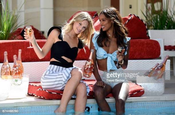 Models Nadine Leopold and Jasmine Tookes enjoy PerrierJouet at Encore Beach Club at Wynn Las Vegas on April 27 2017 in Las Vegas Nevada