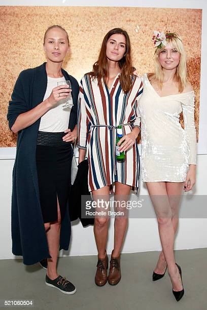 Models Nadya Panchenko and Beth Ostendorf and actress Eugenia Kuzmina attend the Photo Femmes Exhibition Opening at De Re Gallery featuring the work...