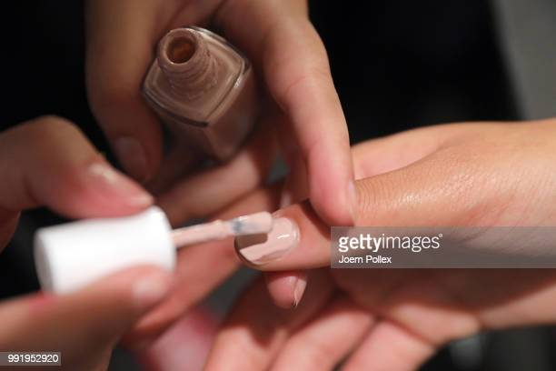 Models nails being painted backstage ahead of the Marina Hoermanseder show during the Berlin Fashion Week Spring/Summer 2019 at ewerk on July 5 2018...