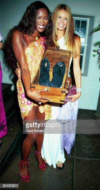 Models Naomi Campbell and Elle MacPherson at a UNICEF party in aid of Kosovo held on June 17 1999 in London