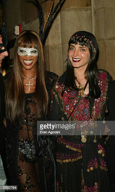 Models Naomi Campbell and Michelle Hicks at Dolce Gabbana's Halloween Party at Cipriani 42nd Street in New York City October 31 2002 Photo by Evan...