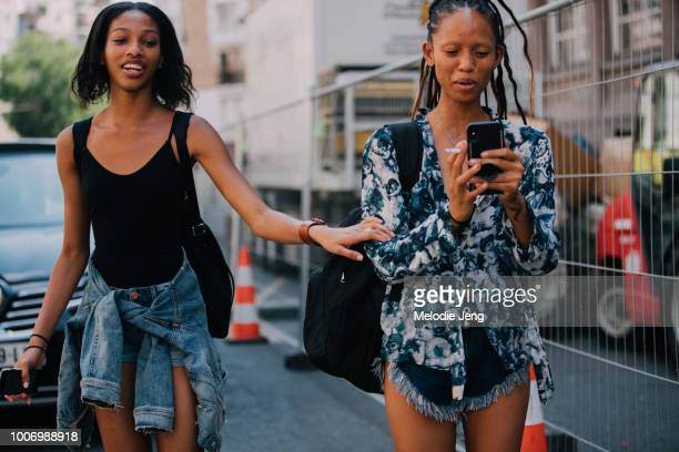 Models Naomi Chin Wing and Adesuwa Aighewi after the Acne Studios Spring/Summer 2019 show during Couture Fall/Winter 2018 Fashion Week on July 1 2018...