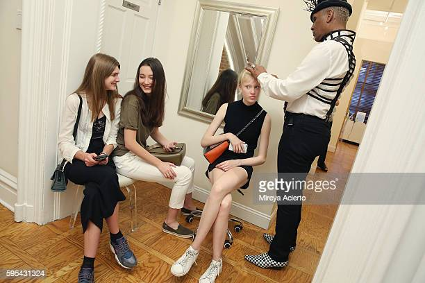 Models Nastya Abramova Alena Nurgaleeva and Christina Christiansen from Wihelmina Models prepare for New York Fashion Week at Verve Spa on August 25...
