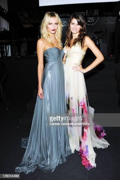 Models Natasha Poly and Isabeli Fontana attend amfAR MILANO 2011 at La Permanente on September 23 2011 in Milan Italy