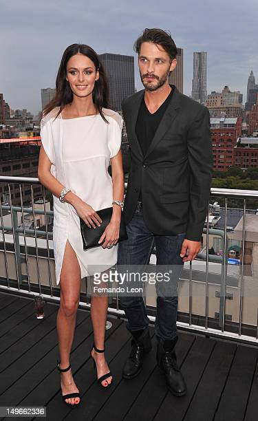 Models Nicole Trunfio and Ben Hill pictured at the David Yurman Rooftop on August 1 2012 in New York City