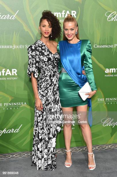 Models Noemie Lenoir and Petra Nemcova attend the amfAR Paris Dinner 2018 at The Peninsula Hotel on July 4 2018 in Paris France
