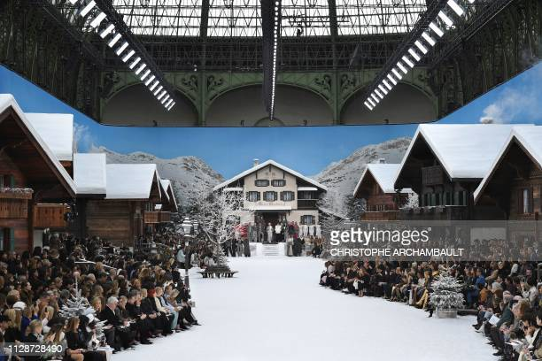 Models observe a minute's silence in tribute to late German fashion designer for Chanel Karl Lagerfeld ahead of the Women's FallWinter 2019/2020...