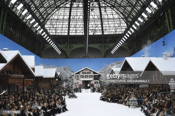 Models observe a minute's silence in tribute to late German fashion designer for Chanel, Karl Lagerfeld, ahead of the Women's Fall-Winter 2019/2020...