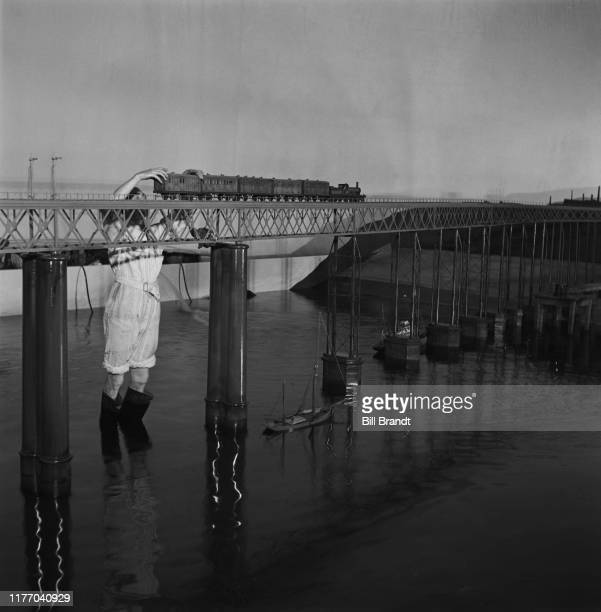 Models of a steam locomotive crossing the Tay Bridge during filming of 'Hatter's Castle' directed by Lance Comfort at Denham Film Studios...