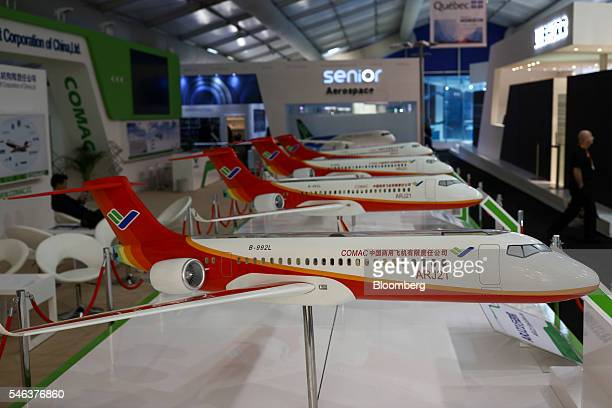 Models of ARJ21 regional jets aircraft manufactured by Commercial Aircraft Corp of China Ltd sit on display on the second day of the Farnborough...