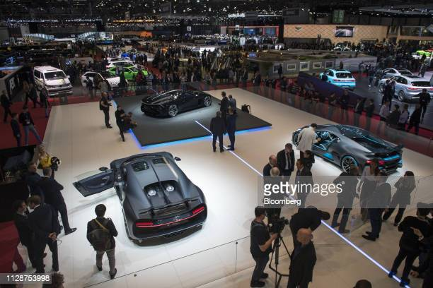 Models of Bugatti Automotive SAS automobiles sit on display on the opening day of the 89th Geneva International Motor Show in Geneva Switzerland on...